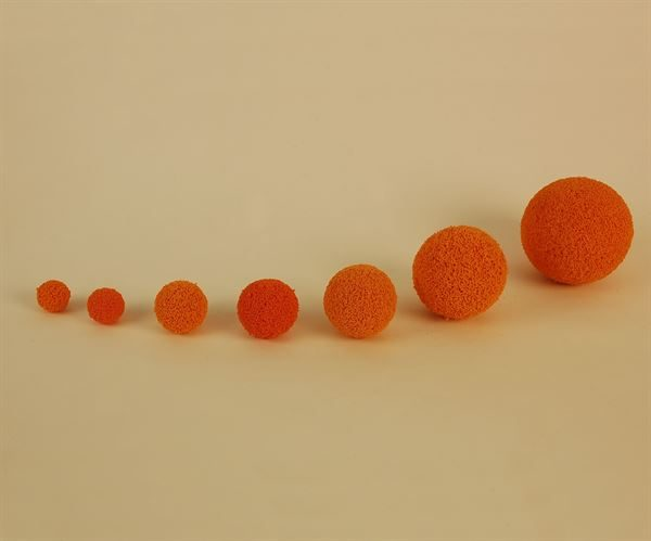 Tube cleaning balls