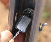 Securing the GPAK's wire rope to the end post, showing cone and Gripple in situ