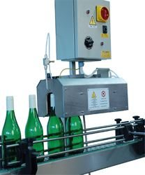 Automatic capsule distributors & shrinkers